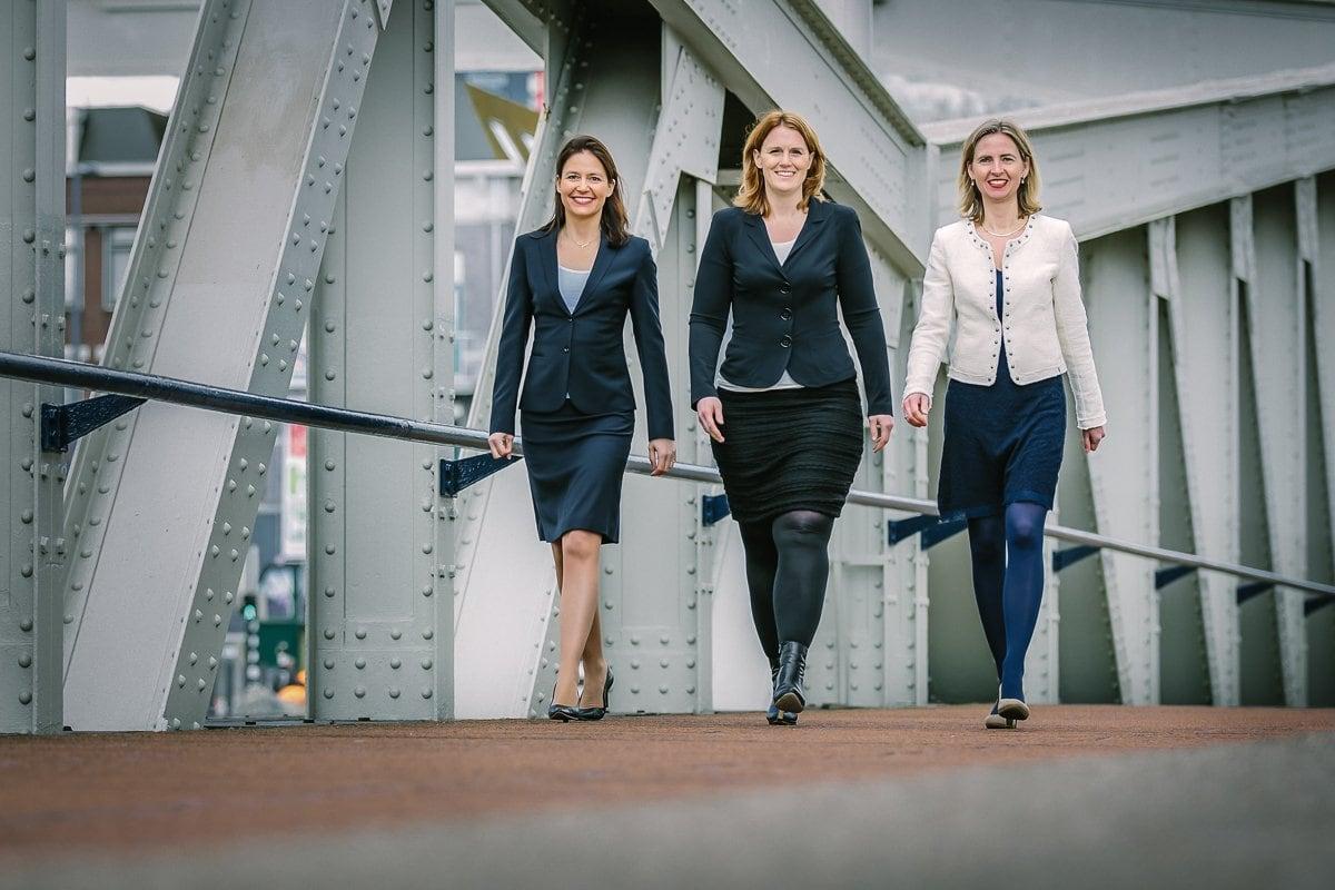 personal branding photo three lady entrepreneurs walking outdoor image steel bridge brand photo