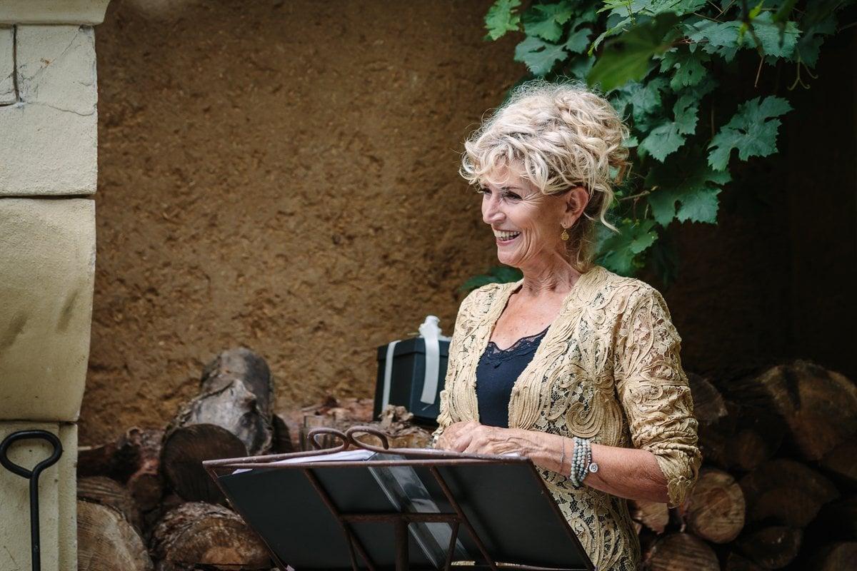 personal branding photo lady registrar at work during wedding ceremony professional brand photographer
