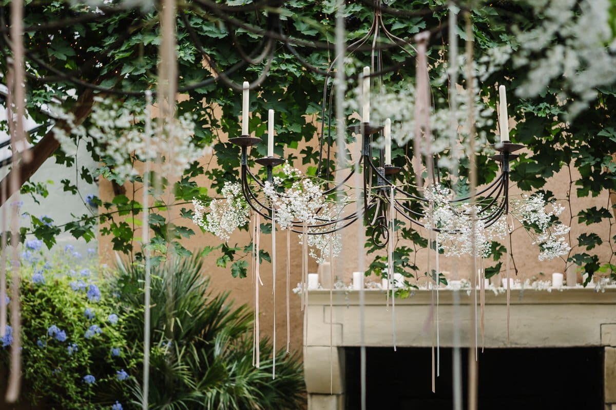 professional venue photography high-quality location image indoor country rustic feel french vibe chandeliers ribbons green leaves orangery orangerie
