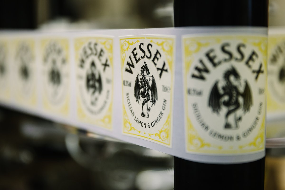 close-up image of wessex gin labels in production line personal branding photo shoot session surrey wessex gin distillery guildford alfred_the_great brand photographer business corporate headshot production stills photo photographer