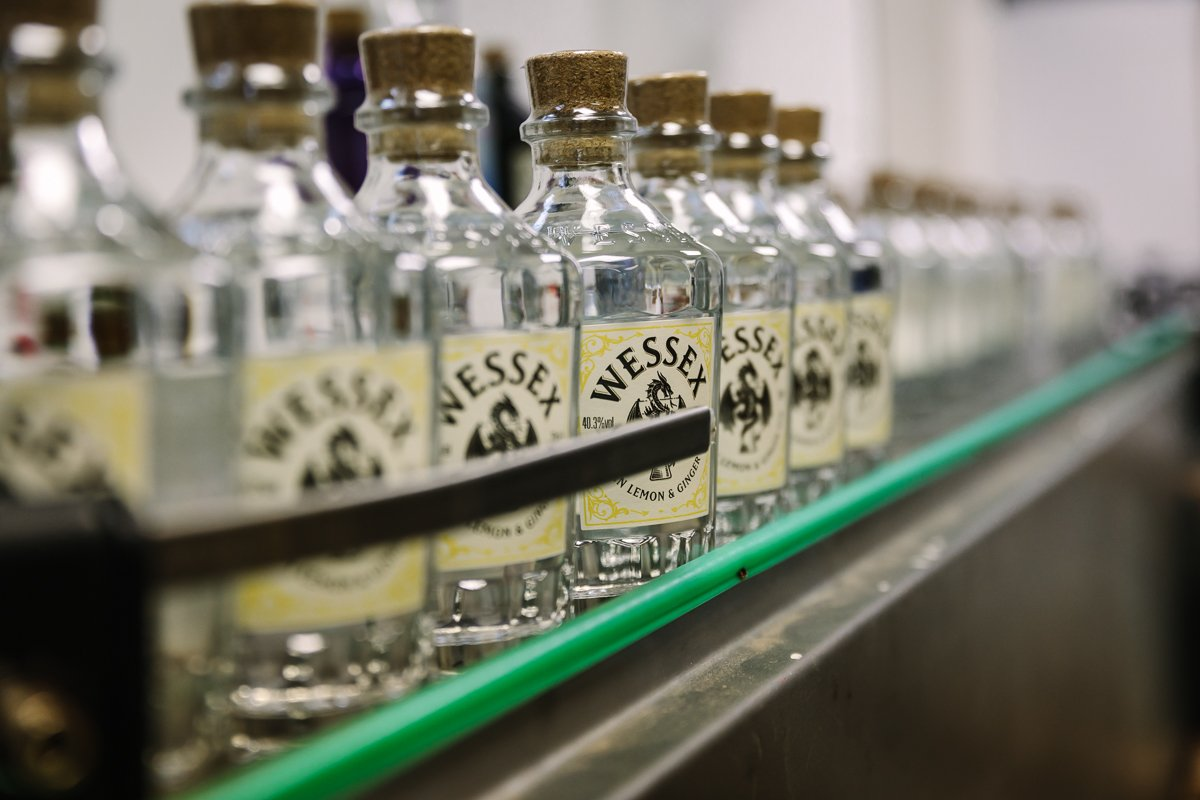 close_up image of gin bottles in production line personal branding photo shoot session surrey wessex gin distillery guildford alfred_the_great brand photographer business corporate headshot production stills photo photographer